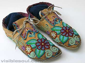 Cree??? moccasins -- note the moose hide base and mix of floral with rounded geometric designs