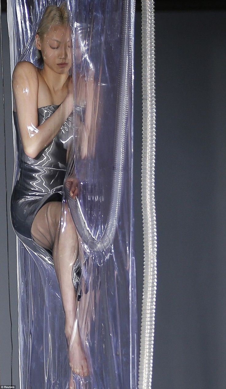 What clothes? While all eyes were on the crazy vacuum-packed displays, the designer, who is loved by Lady Gaga, offered some stylish silver ...