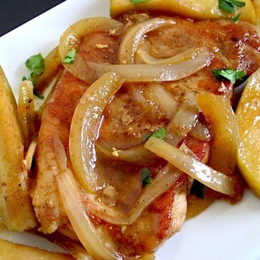 Pork chops smothered with apples, onions, cinnamon, and butter make for a rich and flavorful main dish.