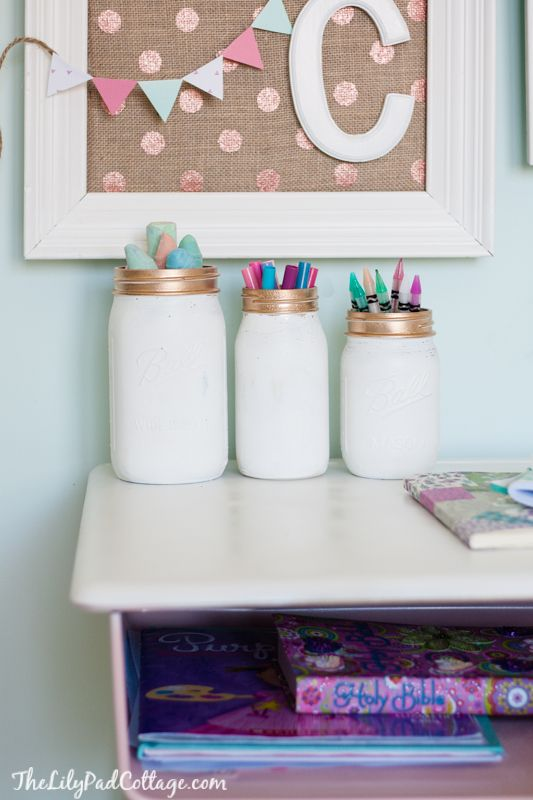 Painted Mason Jars - glam up your old jars with some gold spray paint.  Cute way to hold all those art supplies!