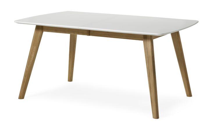 Retro matbord i lättskött material. Bordet förlängs enkelt med iläggsskivan á 45 cm som ingår. Komplettera gärna med tillhörande stolar, förvaringsmöbler samt soffbord och mediabänk.