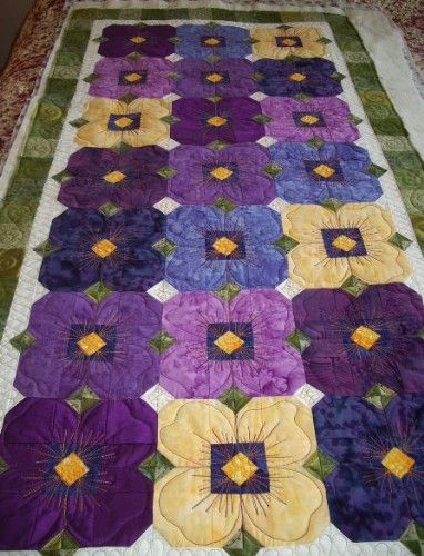 I just finished this little quilt for a customer...  She wanted me to make the flowers look more like pansies.  I'm hoping I achieved her r...
