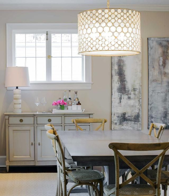 14 best serena images on pinterest chandeliers homes and dinner chic dining room features an oly studio serena drum chandelier hanging over a rectangular dining mozeypictures Images
