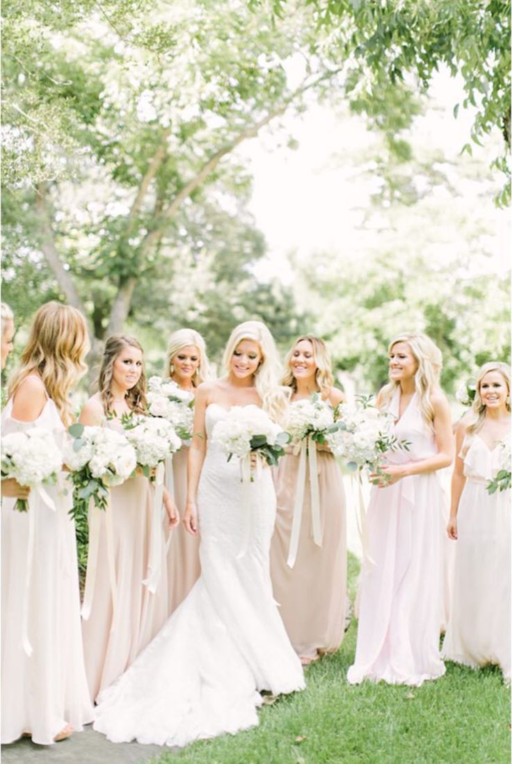 Bride and bridesmaids dresses. Blush white. Created and Styled by Maxit Flower Design and photographed by Mustard Seed.