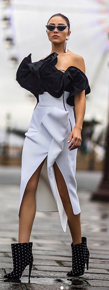 Who made Olivia Culpo's black strapless top, white skirt, sunglasses, and studded ankle boots?