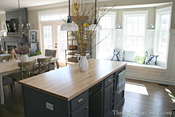 window seat in kitchen.. also love the color of the walls... analytical gray