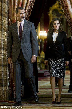 Letizia was beside her king for the meeting, and both wore formal business attire...