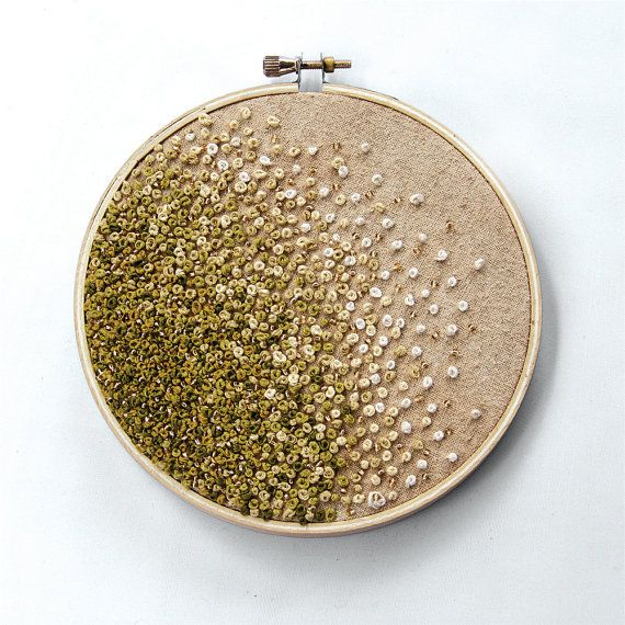 This woman's work is amazing!  She has some really great embroidery jewelry as well.  Mossy Green Gradient Embroidery Hoop Art  by TheChestOfDrawers