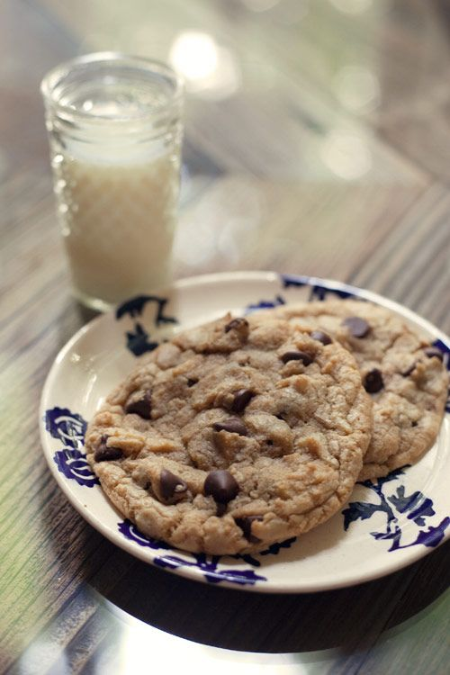 Huge, thick, beautiful, bakery-style chocolate chip cookies. Tender in the middle with just a tiny bit of crispness on the outside. My favorite chocolate chip cookie recipe!