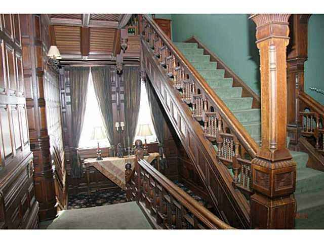 Quality and workmanship...enjoy the opulence of long ago with spectacular woodwork, leaded stained glass, beamed ceilings, gracious and spacious living awaits you in the Reynolds-Secor Mansion with Victorian and Arts and Crafts influence...three floors of unbelievable living space and a two stroy carriage house.