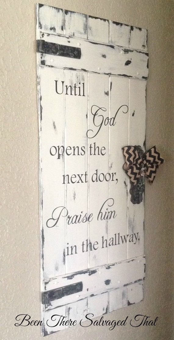 A distressed wood sign made to look like an old rustic door. The ornate hardware and ribbon add a touch of vintage softness. Gotta love big rustic hinges. They remind me of something you might find on an old barn door or farm shed. This door has a lot of dimension and character. It is 36 tall x 17.5 wide making it a nice substantial piece. This door is an original creation of mine. I received a request a couple years ago to create a sign that looked like an old door. My mind set to work and…