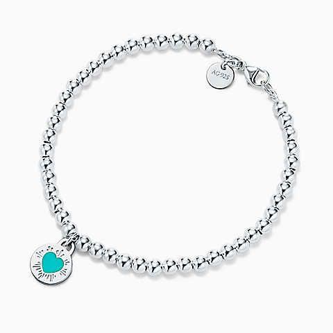Charm rond Cœur Return to Tiffany™, argent 925mil. Bracelet de perles. Medium.