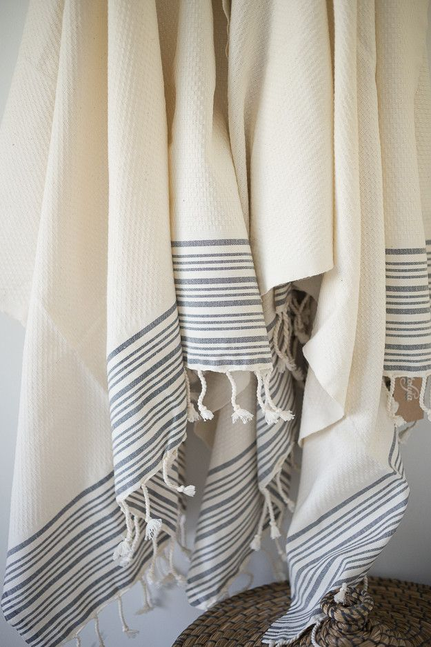 A soft and luxurious flat woven bath towel in white with grey stripes. Made in central Turkey, building on a strong textile heritage, with a contemporary edge. Turkish Hammam Towels are flat woven, fa