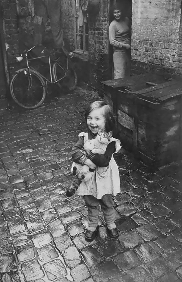 Historical photos of kids being kids Happy French Girl And Her Cat [1959]