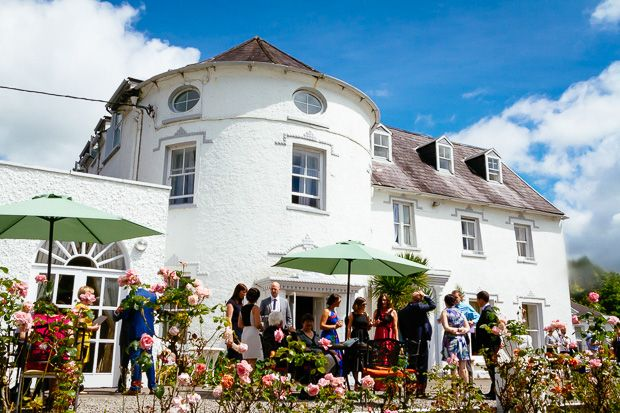 A same sex wedding amongst the gardens at Innishannon House Hote simply bursting with love and colour.