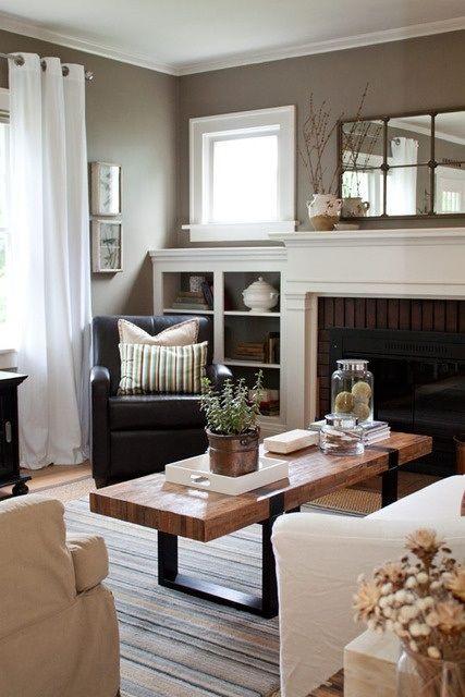 Tan living room, lower built ins, crown moulding, square windows