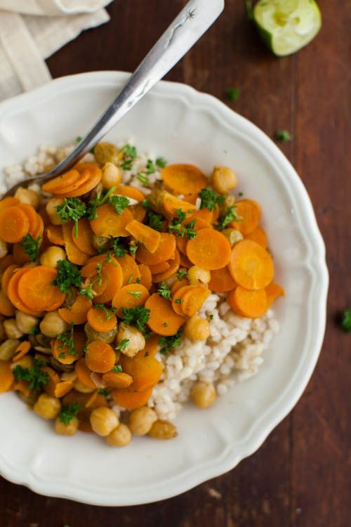 Cumin Braised Carrots and Chickpeas // Preheat oven to 375˚. In a roasting pan, toss together sliced carrots, garlic, chickpeas, raisins, cumin, salt, and olive oil. Spread out into a thin layer. Add vegetable broth and cover roasting pan with foil. Bake carrots for 30 minutes, uncover, and then bake for another 10 minutes. Serve over cooked grains.