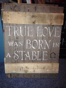 """""""True love was born in a stable"""" Reclaimed wood sign."""
