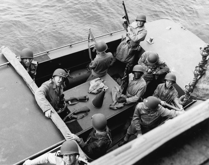 Major General George Patton and Rear Admiral John Hall US Navy (with his helmet backward) prepare to go ashore at Fedhala Morocco during the North African operation 9 November 1942.