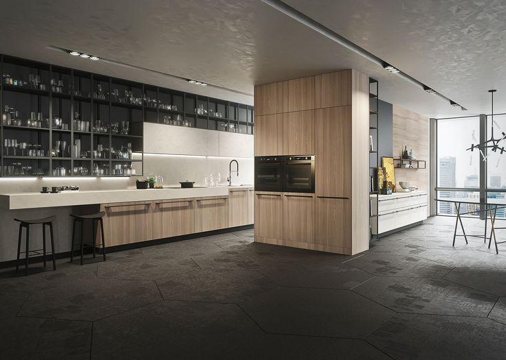 Opera is the quintessential expression of the Made-in-Italy luxury kitchen design: elegant, solid, practical and comfortable. The dramatic volumes of the kitchen become part of the architectural design, making space the protagonist. The design concept seamlessly mixes technology and functionality.