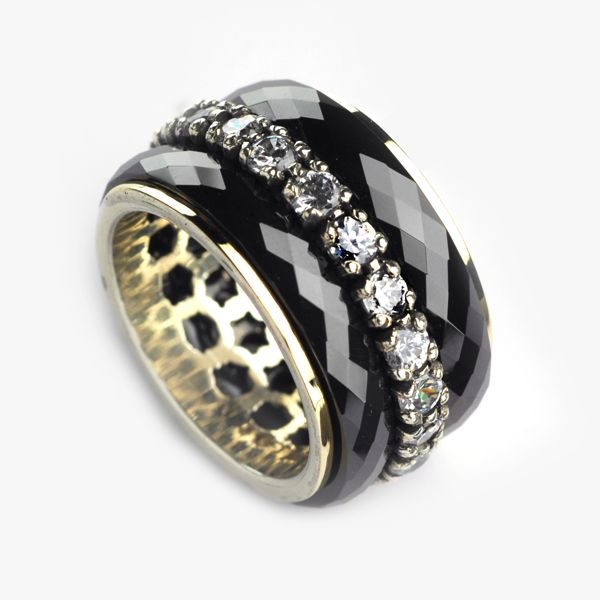 A chic silver ring with bands of 9K gold, black ceramic, and zircons.   Check it out at:  http://grasjewellery.com/index.php/component/virtuemart/rings/silver-gold2013-05-23-18-33-44/27193-detail?Itemid=0