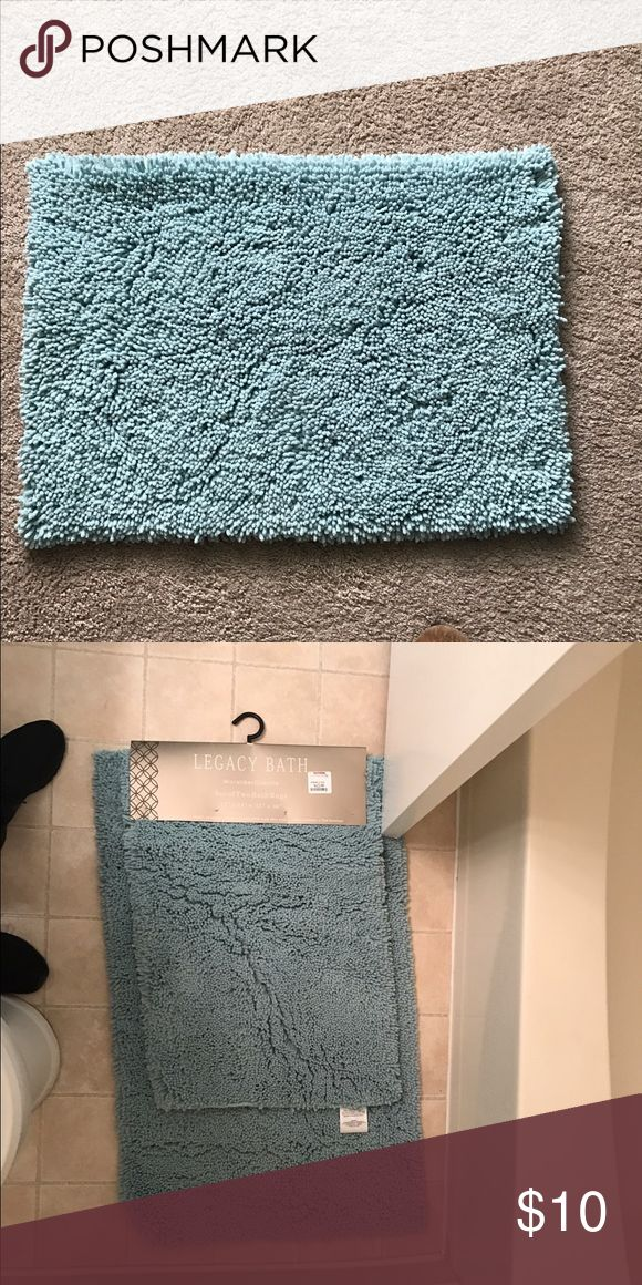 """Bathroom rug Brand: Legacy Bath  Brand new item! I wanted the larger of the 2 items that came in a pack, so I am selling the smaller one!  The size is 17"""" c 24"""" Second picture shows the size difference... the top one is for sale!  Only comes with the top bath rug! Color is a beautiful blue color, more of a Tiffany blue, the picture I believe does a good job with the depiction of the color! Other"""