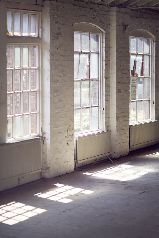 love those windows... how i'd love to fill this room with my things. amazing light, arched brick windows