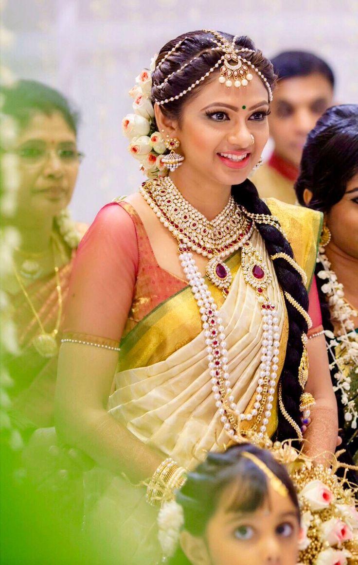 Tamil bride. Wedding. White saree. Pearl jewelry! South Indian Sri Lankan bride, Traditional Southern Indian bride wearing bridal saree, jewellery and hairstyle. #IndianBridalMakeup #IndianBridalFashion South Indian bride. Temple jewelry. Jhumkis. White silk kanchipuram sari.Fishtail side Braid. Tamil bride. Telugu bride. Kannada bride. Hindu bride. Malayalee bride.Kerala bride.South Indian wedding