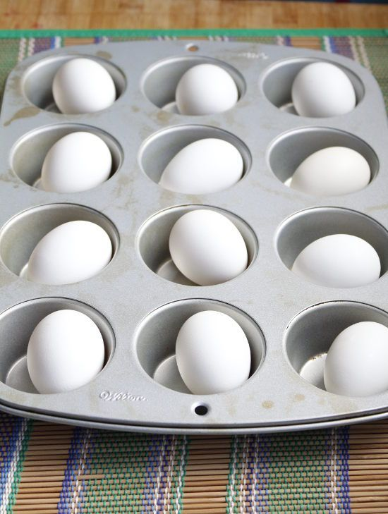 325 degrees for 35 mins = easy, perfect hard boiled eggs. They will have a couple brown spots from the contact with the tin but I just pick em off