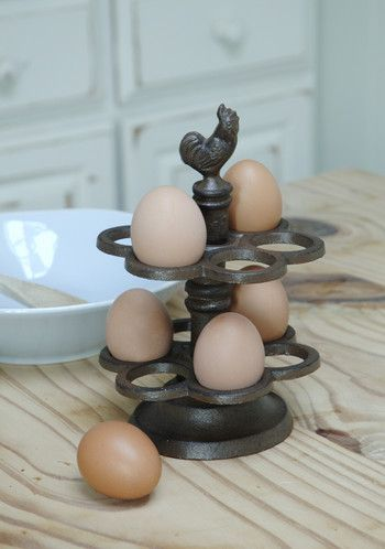 I want one of these soooo much.  It's a sickness: Millicent Meg Cast Iron Egg Holder : Black Country Metalworks Ltd