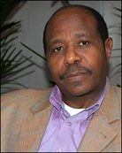 """Paul Rusesabagina, dubbed by some the """"Oskar Schindler of Africa,"""" resisted the madness that surrounded him and quietly sheltered more than 1,200 Tutsis and moderate Hutus within the walls of the luxury hotel he managed. Outside those hotel walls, mobs hunted down their victims and hacked them to death with machetes."""