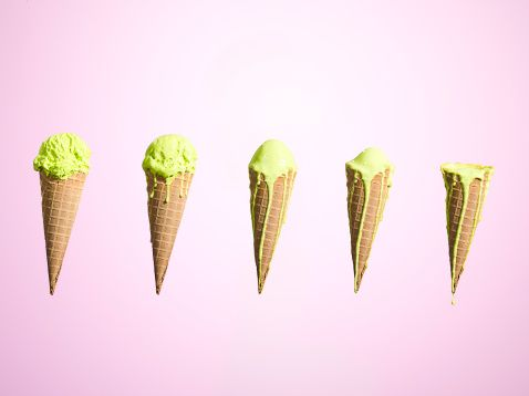 Stock Photo : Row of melting ice creams at different stages