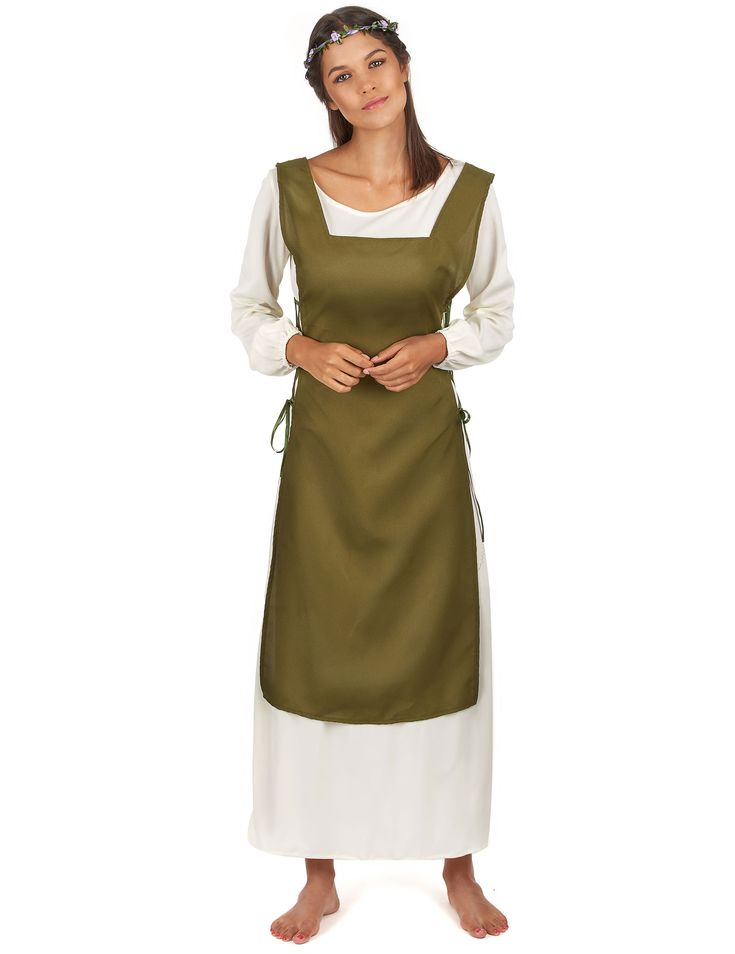 Disfraz campesina medieval: Este disfraz de campesina medieval para mujer incluye vestido, cubre botas y corona de flores. El vestido es blanco roto con mangas elásticas y cuello redondo.El bajo del vestido es verde...