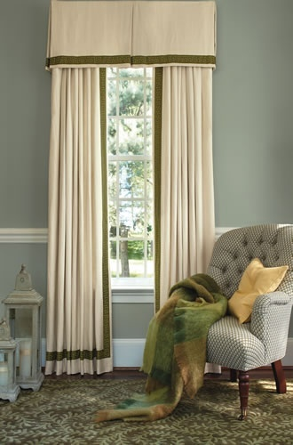 The banded drapes and window valance complete this bedroom scene of greens.
