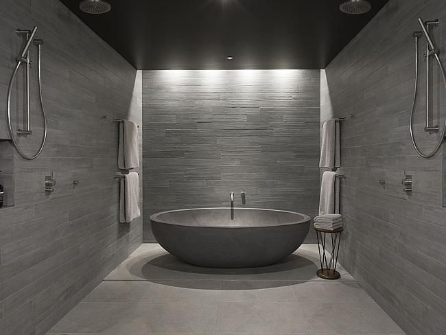 Rough-formed concrete walls feature throughout the property...