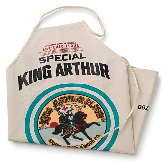 """King Arthur Flour Logo Apron $24.95. Inspired by our favorite ingredient. Visitors to our store here in Norwich, Vermont snap up this logo-wear apron, as a """"souvenir"""" of their visit."""