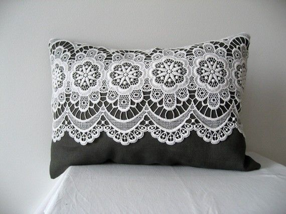A sweet decoration pillow made in all natural fibers. It is made of very fine black-brown-grey linen, and the lace is found at the salvation