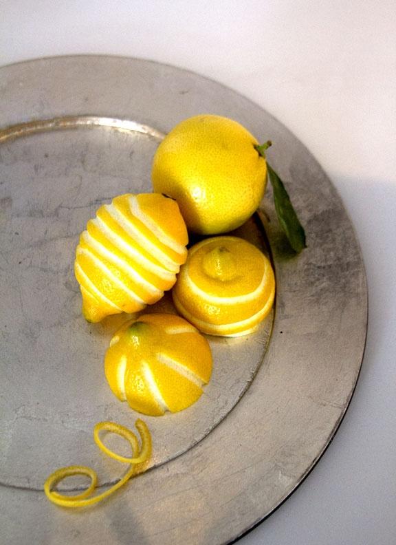 If you're careful cutting the lemon zest, the lemons can make a unique centerpiece. #brunch #patron #centerpiece #lemons #patrontequila #entertaining