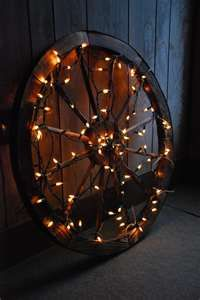 lighted wagon wheel decoration   Because you know I have an extra wagon wheel on hand