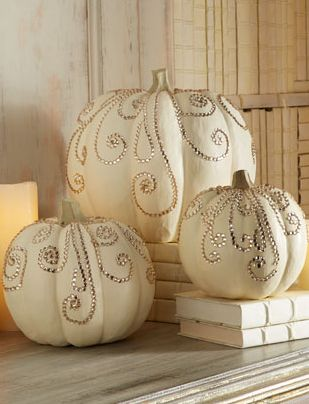 Jeweled pumpkins would be cool for a fall wedding.. gives it a little elegant touch.. love that they are white too