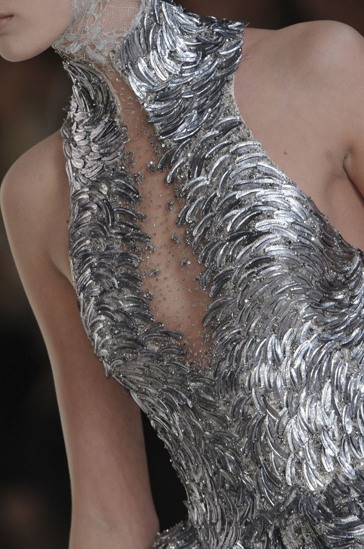 Alexander Mcqueen Spring 2012   It's like the silver swan ballet costume! Love!