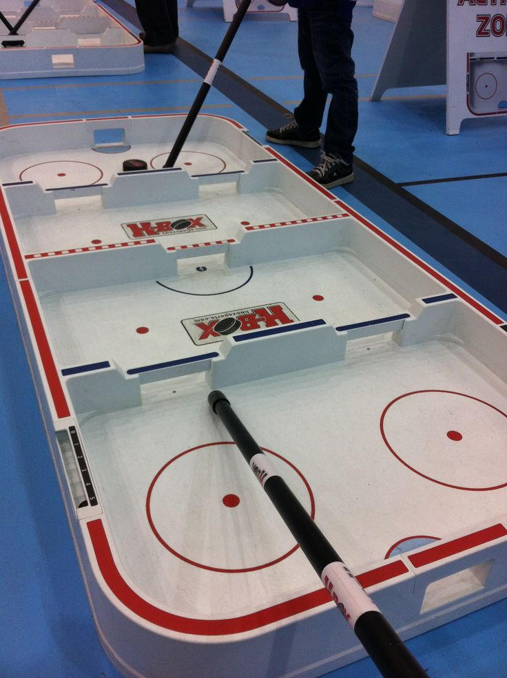 """Think """"street hockey meets table/bubble hockey!""""  A great way to get off the couch, have fun and get fit, while uber-improving your hand-eye coordination & stick handling skills!"""