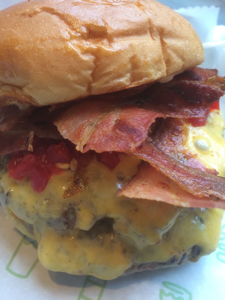 Shake Shack Smokestack burger - http://johnrieber.com/2015/02/04/bite-into-shake-shack-cheese-stuffed-burgers-my-shack-stack-review/