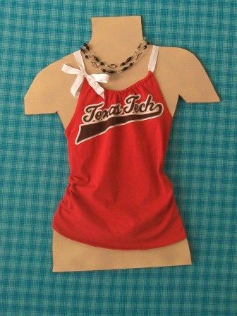 Turn a T-shirt into a tank top! This website also has the instructions for the cutest strapless dress made out of your favorite team tee!