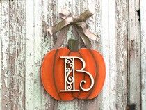 You can create a celebratory and completely customizable pumpkin monogram wreath, thanks to this guide from CraftCuts. Hang it up in your kitchen, dining room or on your front door for guests to enjoy.
