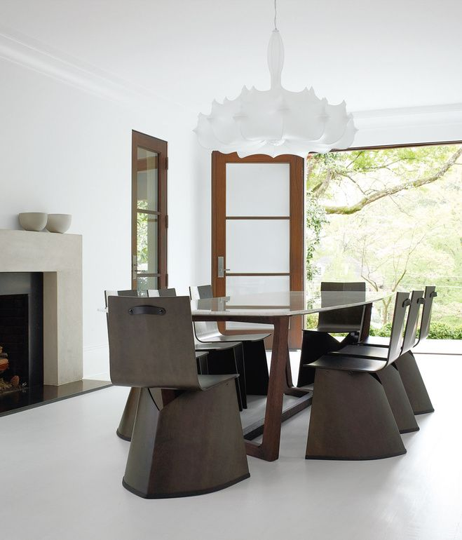 Tk residence dining room konstantin grcics venus chairs for classicon surround a table by poliform in the formal dining room hill selected the flos