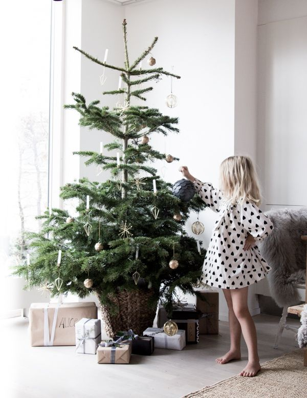 A Scandinavian home at Christmas with Santa's little helper