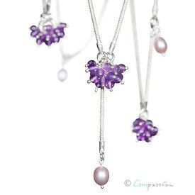 Silver, amethysts and pearls. Jewelry by Kirsti Doukas, Photography by Janne Kommonen