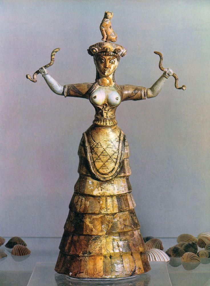 LA DEA DEI SERPENTI- statuetta minoica del II millennio a,C restaurata da Evans, ritrovata a Cnosso ora è conservata al museo di Heraklion