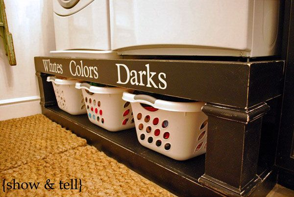I love this idea for the laundry room, raising the appliances and placing the storage under them is great!